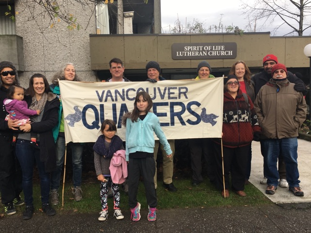 13 members of the Vancouver Quaker community with their banner